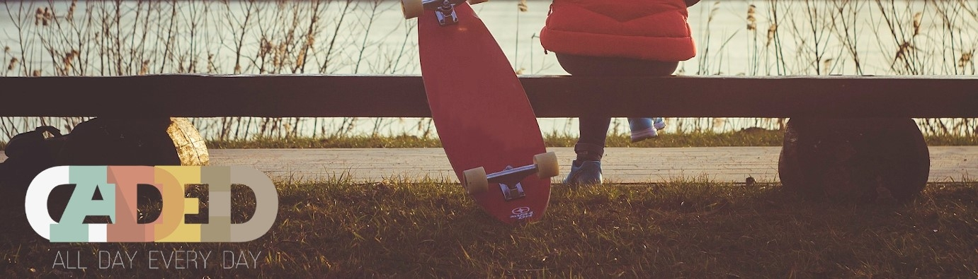 sitting on bench with skateboard